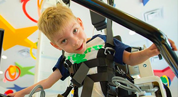 Picture of a child at CRIT using the Lokomat, a robotic rehabilitation device for gait training