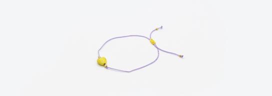 Purple bracelet with yellow heart